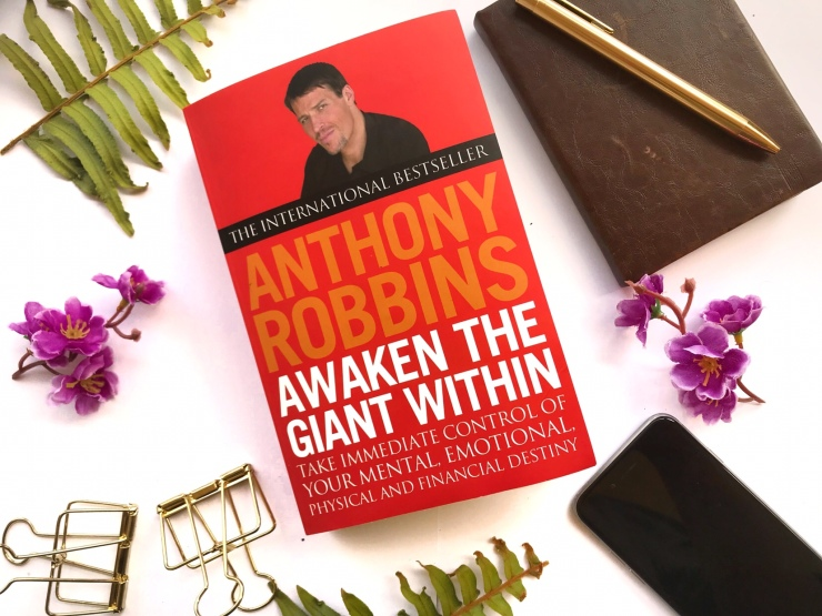 "Tony Robbins, ""Awaken the Giant Within"" on paperback"